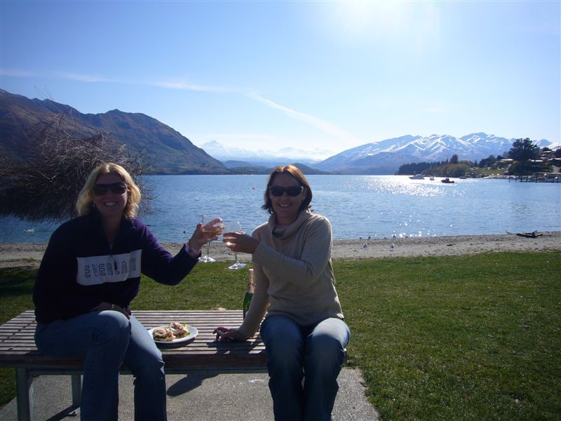 Enjoying a glass of New Zealand by the lake in Wanaka